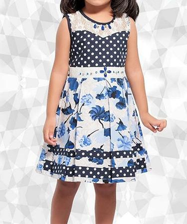 AMB by Tolani bespoke fashion for girls. Girl in pretty blue dress with floral pattern.